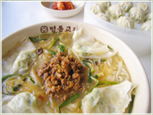 A noodle soup with beef and dumplings.  Photo courtesy The Official Korea Tourism Site.